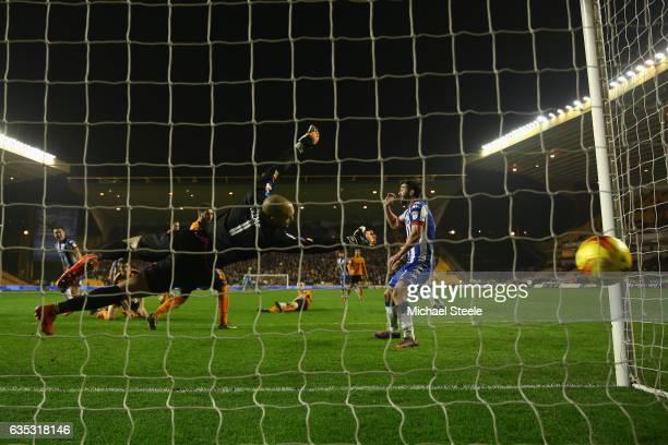 Jake Buxton of Wigan heads past Carl Ikeme of Wolverhampton to score the winning goal during the Sky Bet Championship match between Wolverhampton...