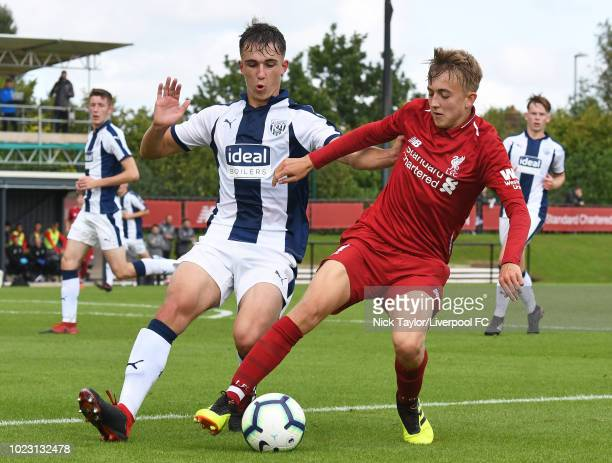 Jake Cain of Liverpool and Pablo Martinez of West Bromwich Albion in action during the Liverpool U18 v West Bromwich Albion U18 game at The Kirkby...