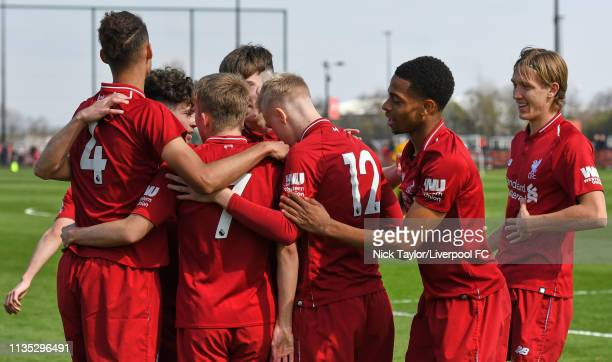 Jake Cain of Liverpool celebrates scoring Liverpool's first goal with team mates in the Liverpool v Wolverhampton Wanderers U18 Premier League match...