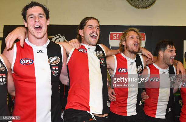 Jake Carlisle Josh Bruce Sam Gilbert and Koby Stevens of the Saints sing the song after winning the round seven AFL match between the St Kilda Saints...