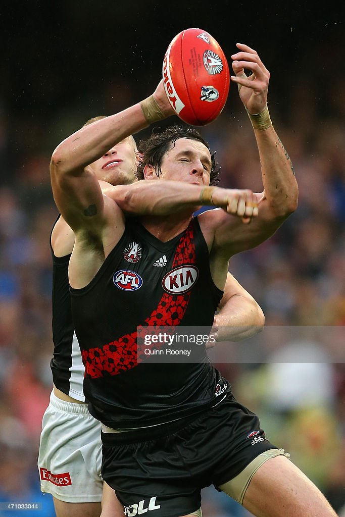 Jake Carlisle of the Bombers marks infront of Jack Frost of the Magpies during the round four AFL match between the Essendon Bombers and the Collingwood Magpies at Melbourne Cricket Ground on April 25, 2015 in Melbourne, Australia.