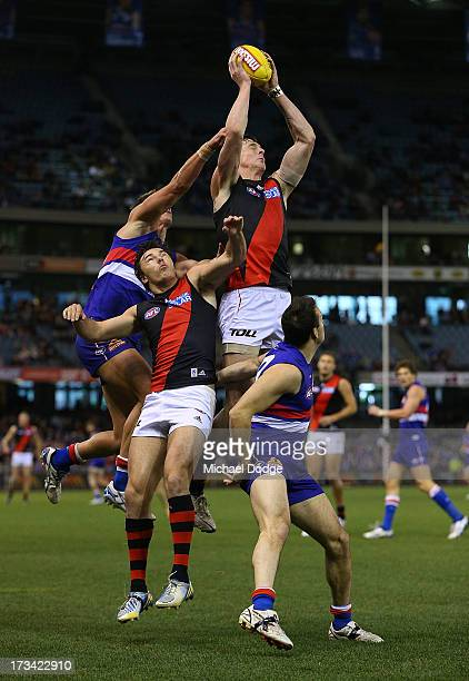 Jake Carlisle of the Bombers marks the ball during the round 16 AFL match between the Western Bulldogs and the Essendon Bombers at Etihad Stadium on...