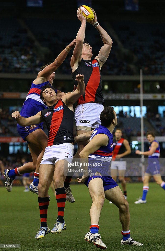 Jake Carlisle of the Bombers marks the ball during the round 16 AFL match between the Western Bulldogs and the Essendon Bombers at Etihad Stadium on July 14, 2013 in Melbourne, Australia.