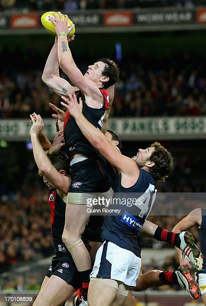 Jake Carlisle of the Bombers takes a mark in the final minute to win the game during the round 11 AFL match between the Essendon Bombers and the...