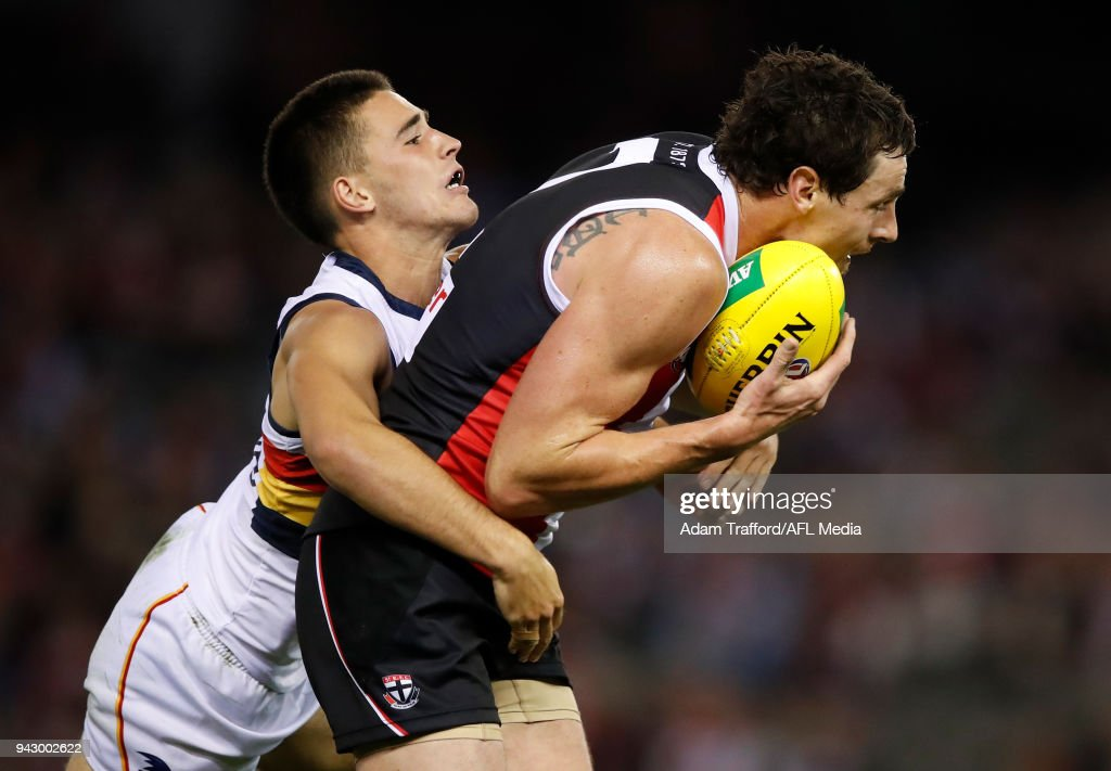 Jake Carlisle of the Saints is tackled by Lachlan Murphy of the Crows during the 2018 AFL round 03 match between the St Kilda Saints and the Adelaide Crows at Etihad Stadium on April 7, 2018 in Melbourne, Australia.