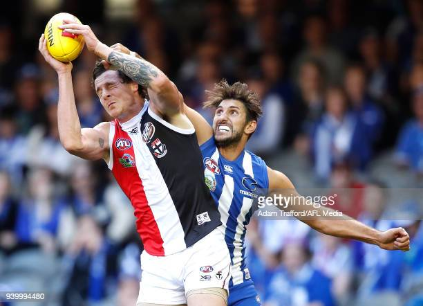 Jake Carlisle of the Saints marks the ball ahead of Jarrad Waite of the Kangaroos during the 2018 AFL round 02 Good Friday Kick for the Kids match...