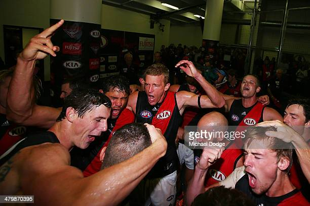 Jake Carlisle Patrick Ryder Dustin Fletcher Paul Chapman and Martin Gleeson celebrate their win during the round one AFL match between the North...