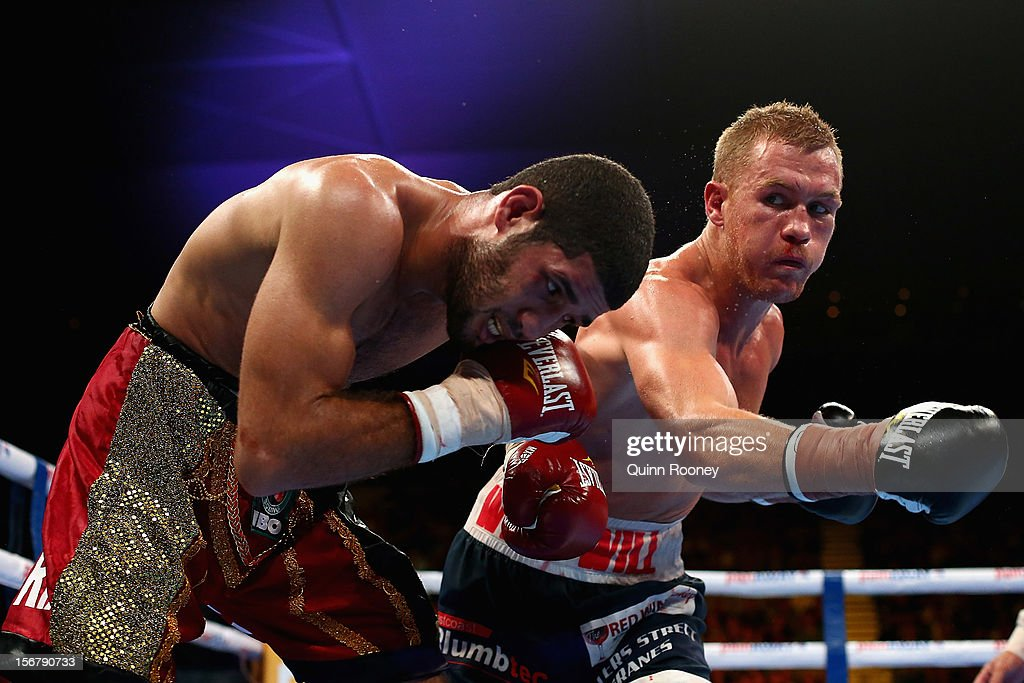 Jake Carr punches Dinesh Kanth of Sri Lanka in their Super Middleweight undercard bout before the world title bout between Danny Green of Australia and Shane Cameron of New Zealand at Hisense Arena on November 21, 2012 in Melbourne, Australia.