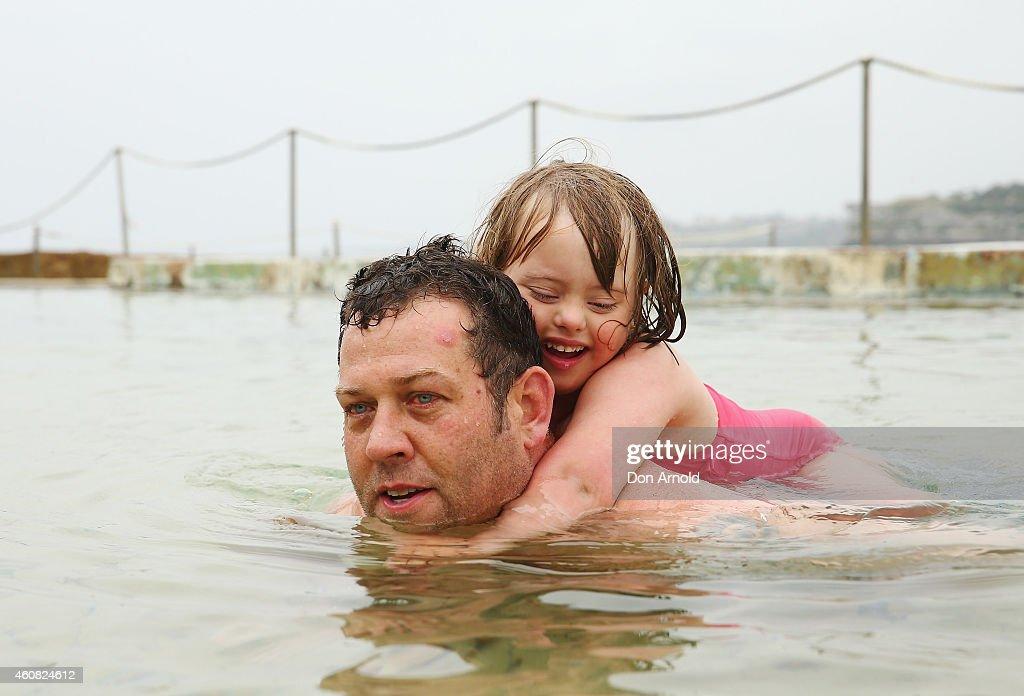 Jake Carter piggy-backs his daughter Jaime Carter in the wading pools at Bondi Beach on December 25, 2014 in Sydney, Australia. Bondi Beach is a popular tourist destination on Christmas Day.