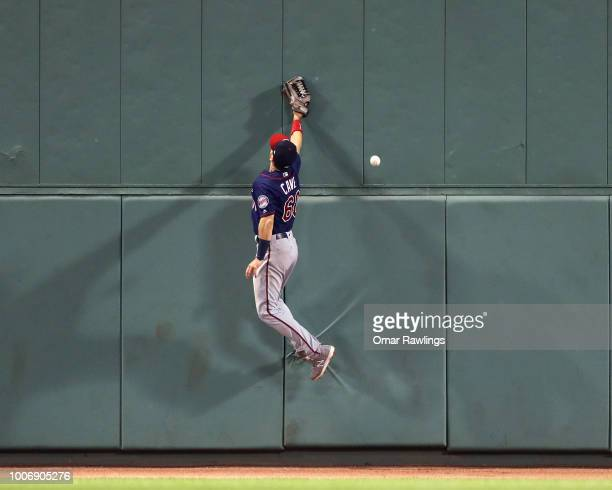 Jake Cave of the Minnesota Twins attemps to catch a fly ball in the bottom of the seventh inning of the game against the Boston Red Sox at Fenway...