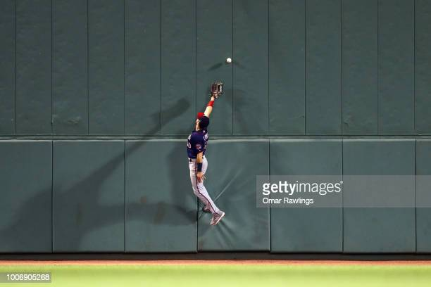 Jake Cave of the Minnesota Twins attempts to catch a fly ball in the bottom of the seventh inning of the game against the Boston Red Sox at Fenway...