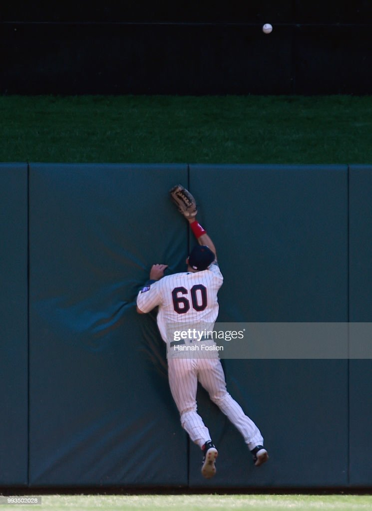 Jake Cave #60 of the Minnesota Twins collides with the center field wall as the two-run home run ball hit by Chris Davis #19 of the Baltimore Orioles goes out during the first inning of the game on July 7, 2018 at Target Field in Minneapolis, Minnesota.
