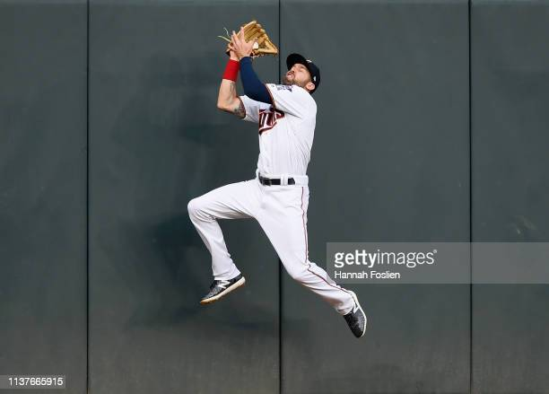 Jake Cave of the Minnesota Twins makes a catch in left field of the ball hit by Rowdy Tellez of the Toronto Blue Jays during the second inning of the...