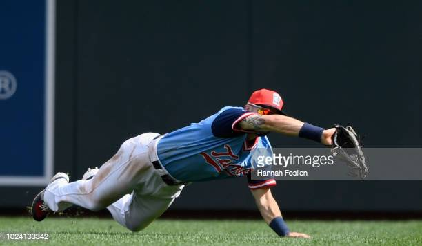 Jake Cave of the Minnesota Twins makes a catch in right field of the ball hit by Ramon Laureano of the Oakland Athletics during the eighth inning of...