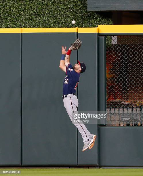 Jake Cave of the Minnesota Twins makes a leaping catch neaer the wall on a fly ball by George Springer of the Houston Astros in the seventh inning at...