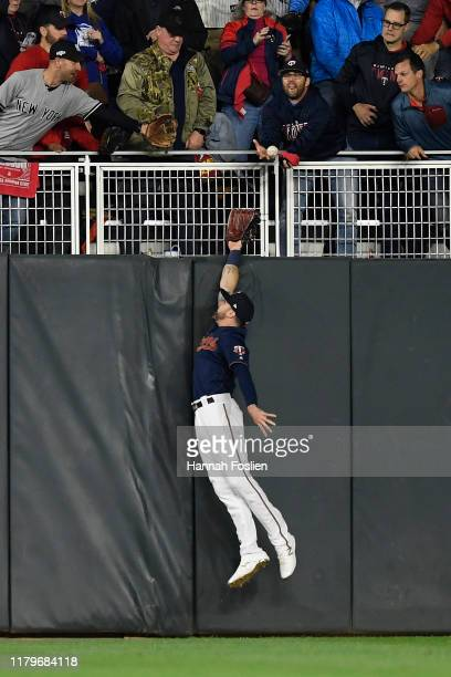 Jake Cave of the Minnesota Twins makes an attempt on a home run hit by Gleyber Torres of the New York Yankees in the second inning in game three of...