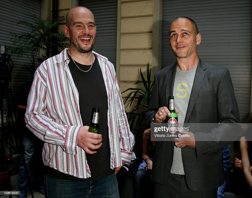 Jake Chapman (L) and Dinos Chapman (R) attend the Jake And Dinos Chapman Opening At The ProjectB Gallery on May 25, 2010 in Milan, Italy.