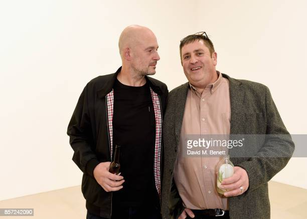 Jake Chapman and guest attend the private view of 'The Disasters of Everyday Life' by Jake Dinos Chapman at Blain|Southern on October 3 2017 in...