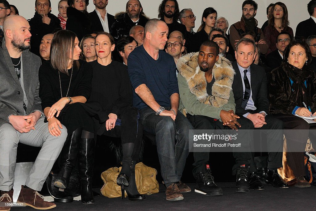 Jake Chapman, guest, Tiphaine de Lussy, Dinos Chapman, Kanye West, Michael Burke and Suzy Menkes attend the Louis Vuitton Men Autumn / Winter 2013 show as part of Paris Fashion Week on January 17, 2013 in Paris, France.