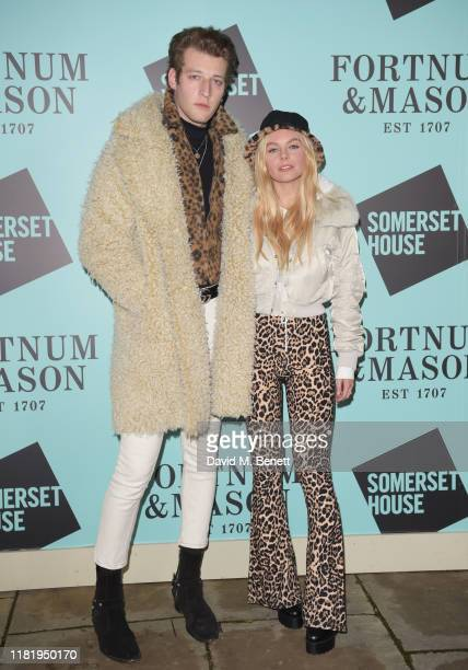 Jake Chatterton and Nell Hudson attend the opening party of Skate at Somerset House on November 12 2019 in London England Celebrating its 20th...