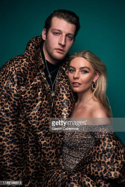 Jake Chatterton and Nell Hudson pose in the GAY TIMES Honours 500 studio at Magazine London on November 21 2019 in London England