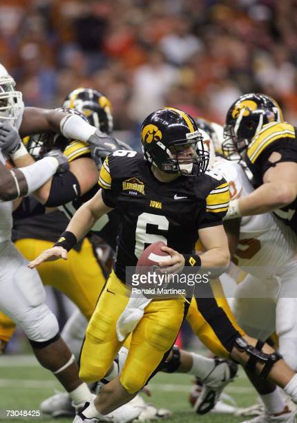 Jake Christensen of the Iowa Hawkeyes runs with the ball against the Texas Longhorns during the Alamo Bowl on December 30 2006 at the Alamodome in...