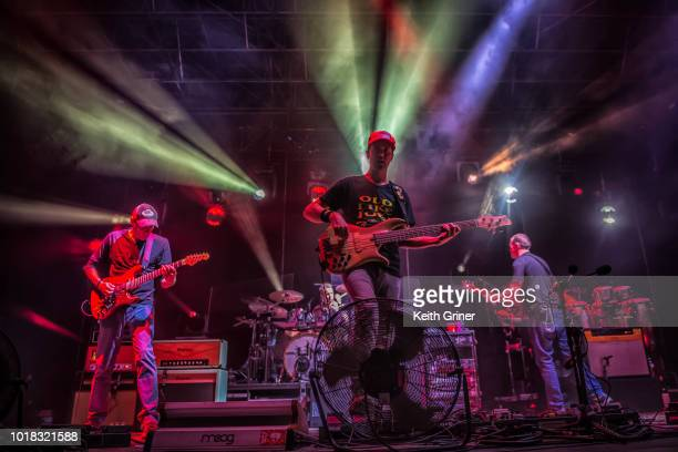 Jake Cinninger Ryan Stasik and Brendan Bayliss of Umphrey's McGee perform at The Lawn at White River State Park on August 11 2018 in Indianapolis...
