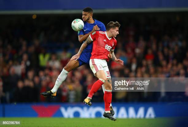 Jake ClarkeSalter of Chelsea and Jason Cummings of Nottingham Forest during the Carabao Cup Third Round match between Chelsea and Nottingham Forest...