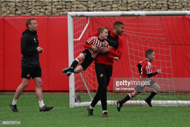 Jake ClarkeSalter uses his height against an under 9 player during a training session between the First Team and the under 9's at The Academy of...
