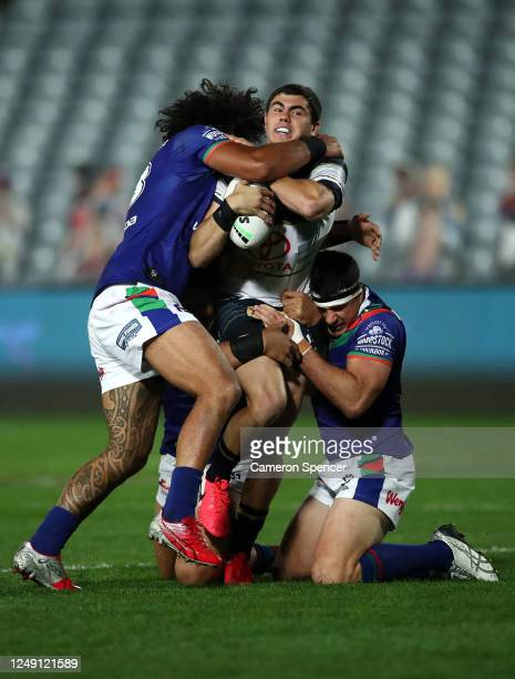 Jake Clifford of the Cowboys is tackled during the round five NRL match between the New Zealand Warriors and the North Queensland Cowboys at Central...