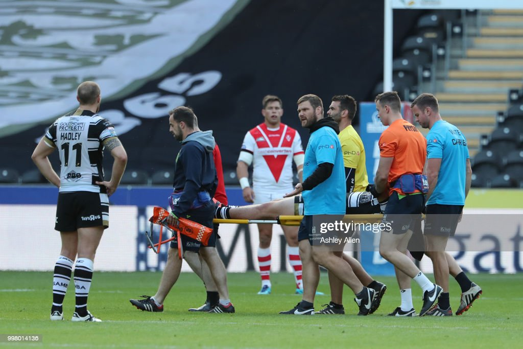 Jake Connor of Hull FC is carried off injured during the BetFred Super League match between Hull FC and St Helens Saints at the KCOM Stadium on July 13, 2018 in Hull, England.