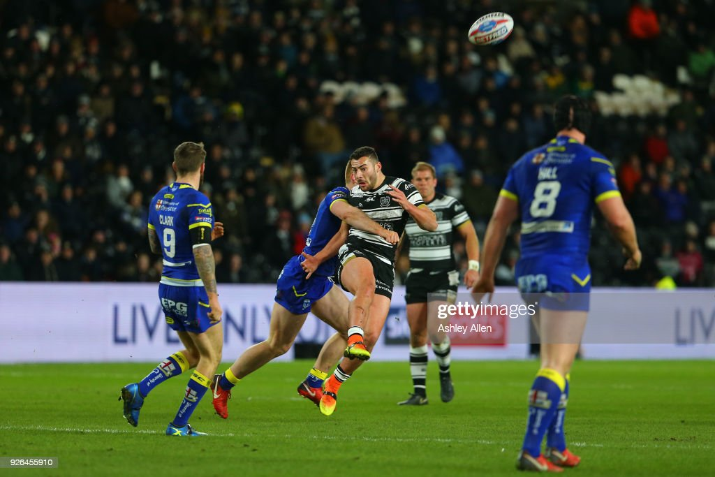 Jake Connor of Hull FC is tackled by Jack Hughes of Warrington Wolves during the BetFred Super League match between Hull FC and Warrington Wolves at KCOM Stadium on March 2, 2018 in Hull, England.