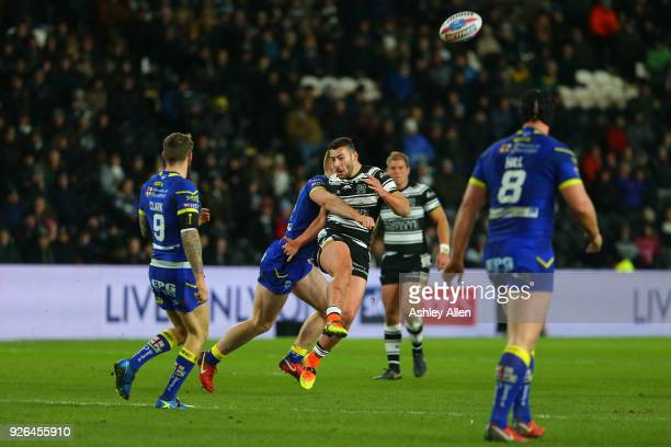 Jake Connor of Hull FC is tackled by Jack Hughes of Warrington Wolves during the BetFred Super League match between Hull FC and Warrington Wolves at...