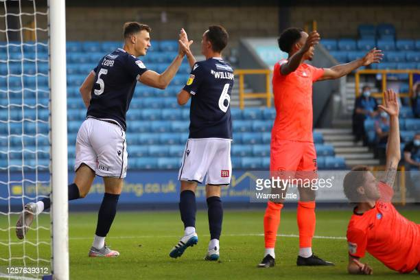 Jake Cooper of Millwall celebrates scoring his teams second goal during the Sky Bet Championship match between Millwall and Huddersfield Town at The...