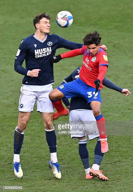 Jake Cooper of Millwall FC and Tyrhys Dolan of Blackburn Rovers battle for the ball during the Sky Bet Championship match between Millwall and...
