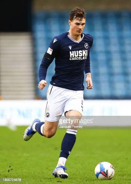 Jake Cooper of Millwall FC runs with the ball during the Sky Bet Championship match between Millwall and Sheffield Wednesday at The Den on February...
