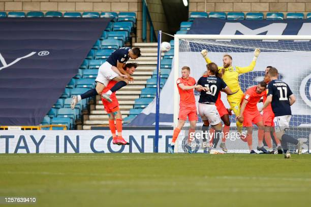 Jake Cooper of Millwall scores during the Sky Bet Championship match between Millwall and Huddersfield Town at The Den on July 22 2020 in London...