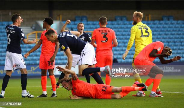 Jake Cooper of Millwall scores his teams second goal during the Sky Bet Championship match between Millwall and Huddersfield Town at The Den on July...