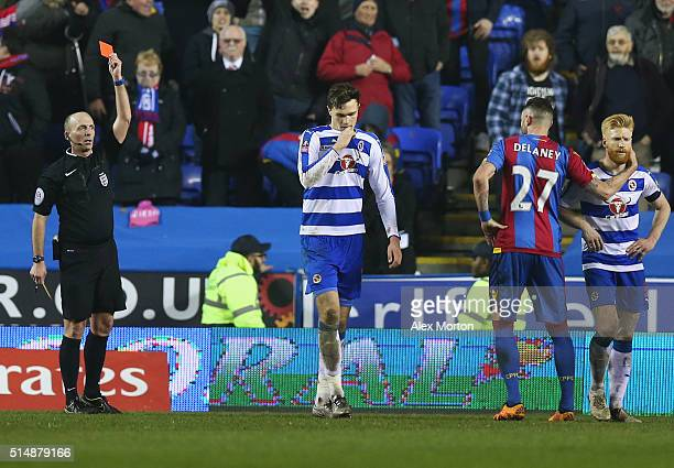 Jake Cooper of Reading is shown a red card by referee Mike Dean and is sent off during the Emirates FA Cup sixth round match between Reading and...