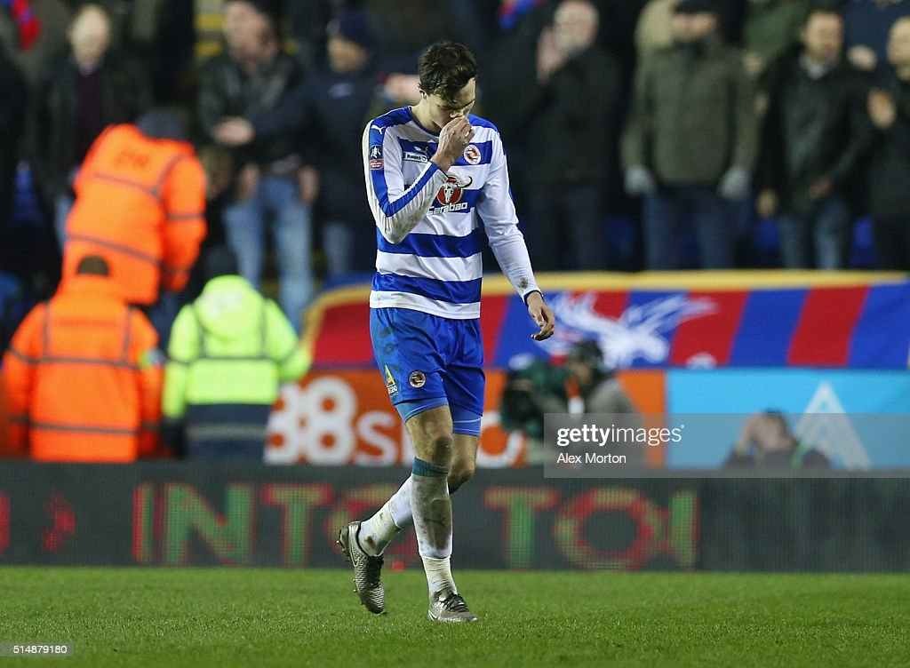 Jake Cooper of Reading looks dejected as he is sent off during the Emirates FA Cup sixth round match between Reading and Crystal Palace at Madejski Stadium on March 11, 2016 in Reading, England.