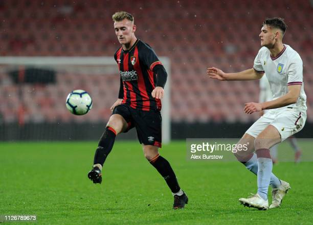 Jake Cope of AFC Bournemouth controls the ball under pressure from Aaron Pressley of Aston Villa during the FA Youth Cup Fifth Round Match between...