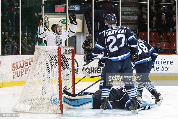 Jake Coughler of the Gatineau Olympiques celebrates as he scored his second period goal against the Chicoutimi Sagueneens on February 20, 2015 at...