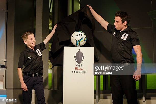 Jake Creasey and James Officer unveil the new ball design for the upcoming FFA Cup during the round of 32 draw announcement at the FFA Offices on...