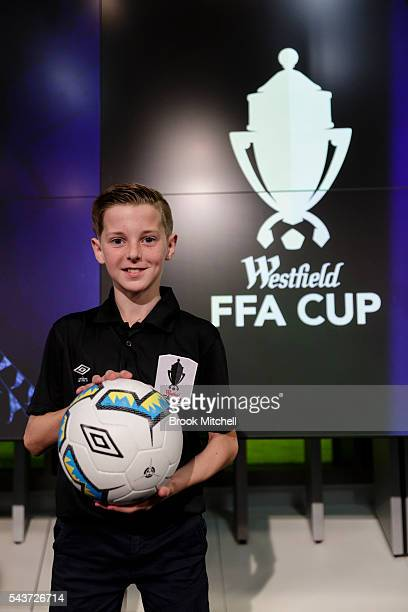 Jake Creasy poses with the new ball for the upcoming FFA cup during the FFA Cup round of 32 draw announcement at the FFA Offices on June 30 2016 in...