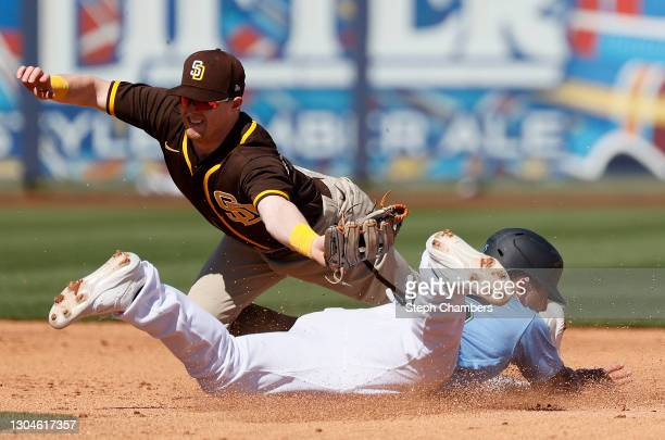 Jake Cronenworth of the San Diego Padres fails to tag out Dylan Moore of the Seattle Mariners at second base in the second inning during the MLB...