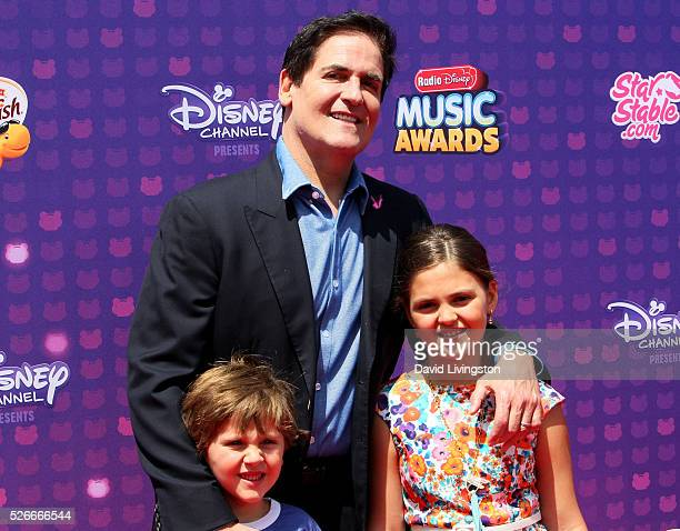 Jake Cuban Mark Cuban and Alyssa Cuban attend the 2016 Radio Disney Music Awards at Microsoft Theater on April 30 2016 in Los Angeles California
