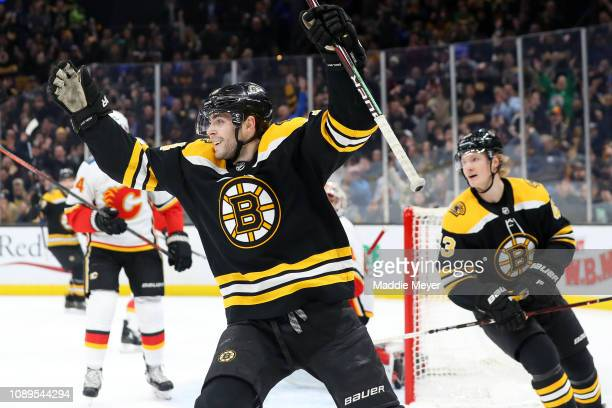 Jake DeBrusk of the Boston Bruins celebrates after John Moore scored a goal during the game between the Boston Bruins and Calgary Flames at TD Garden...