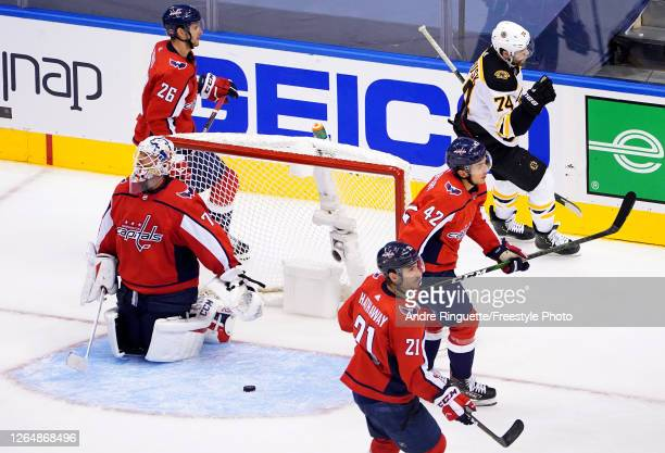 Jake DeBrusk of the Boston Bruins celebrates after scoring a goal on Braden Holtby of the Washington Capitals during the third period in an Eastern...