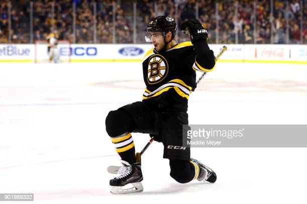Jake DeBrusk of the Boston Bruins celebrates after scoring against the Carolina Hurricanes during the first period at TD Garden on January 6 2018 in...