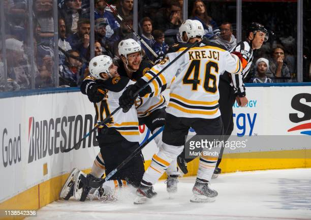 Jake DeBrusk of the Boston Bruins celebrates his goal against the Toronto Maple Leafs with teammates David Pastrnak and David Krejci during the...